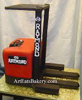 Custom unique red and black 3D forklift retirement cake