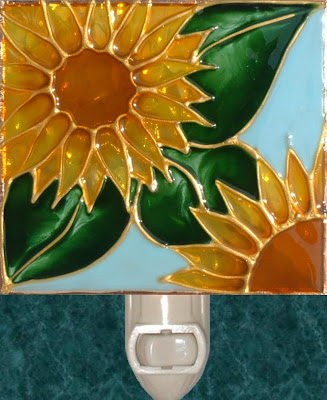 sunflower with leaves and pale blue frame