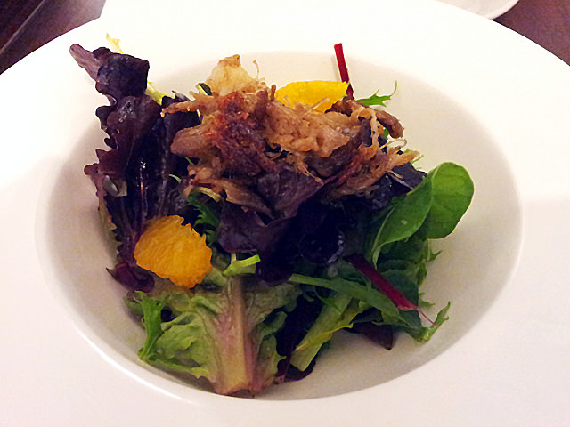 Mesclun salad with lemon vinaigrette and crispy duck