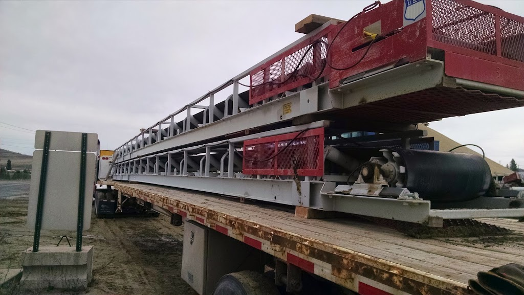 conveyor equipment loaded and secured on extended stretch flatbed trailer