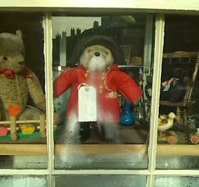 Paddington bear with suspicious like breath condensation on shop window