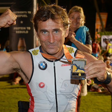 Mission completed: BMW works driver Alessandro Zanardi masters his first long-distance triathlon in ...
