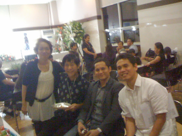 Tess Balingit with Eli Aringay and Oliver John Cabasan of CCF Love Joy Peace Missions Laminin