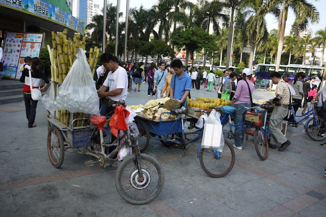 tricycle carts in China with a items such as sugar cane and jackfruit