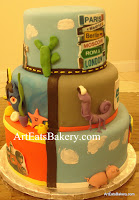 Disney - Pixar kid's birthday cake with Cars, cacti , finding Nemo starfish, Monsters Inc. Toy Story pig and the Incredibles