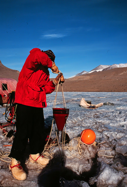 Conrad Cooper pulls a sediment trap out of Lake Bonney, 1994-1995 season.