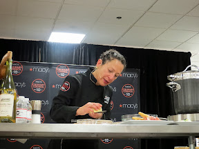 Culinary Council Recap: Nancy Silverton, Culinary Council member at the Macy's at Washington Square Dec 14, 2013, is a big fan of the microplane as she grates a little pile of pecorino where she will plate the Brussels Sprouts Salad