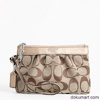 "SIGNATURE PLEATED WRISTLET F43434  Signature fabric with leather trim Fabric lining, zip-top closure 12¡± strap with clip to attach to the inside of a larger bag, or to form a wrist strap 6 1/2"" (L) x 4 3/4"" (H)"