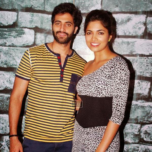 Akshay Oberoi and Parvathy Omanakuttan pose together during the promotion of Bollywood movie Pizza 3D, held at Malad, on July 11, 2014.(Pic: Viral Bhayani)