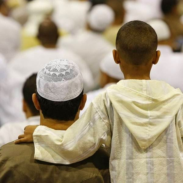 A boy attends prayers for the Eid al-Fitr holiday at the Parc Chanot exhibition centre, in Marseille.