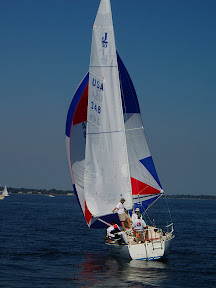 J/30 one-design sailboat- sailing downwind under spinnaker