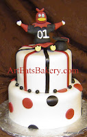 Two tier white black and garnet custom USC Gamecock mascot, polka dot birthday and graduation cake