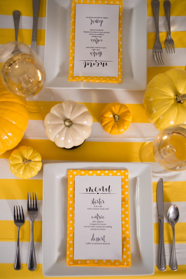 Yellow black and white Thanksgiving wedding decor ideas with polka dot napkins