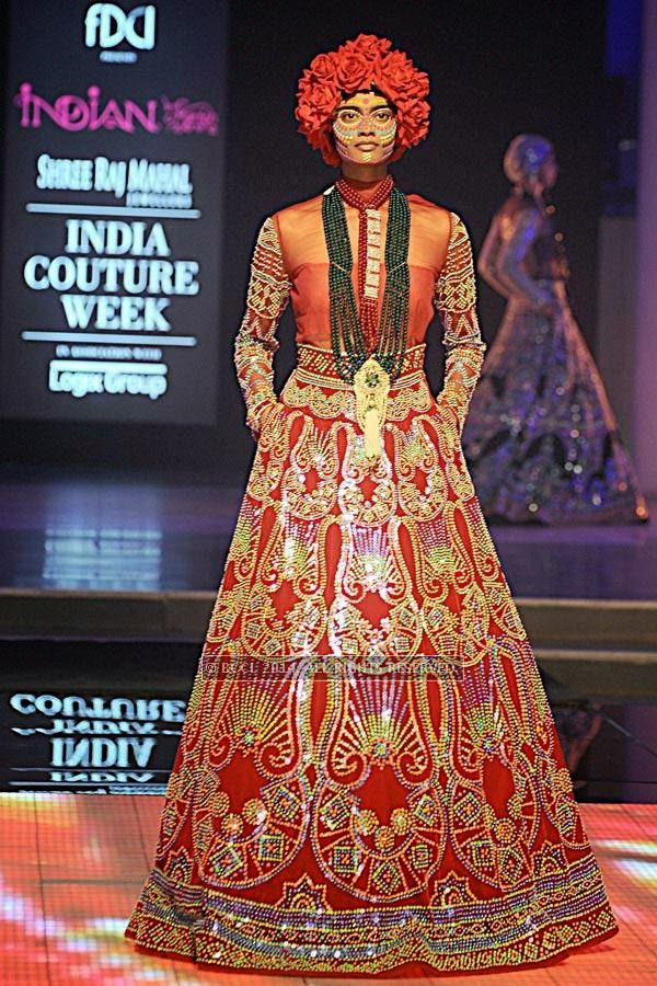 A model showcases a creation by designer Manish Arora on Day 3 of India Couture Week, 2014, held at Taj Palace hotel, New Delhi.