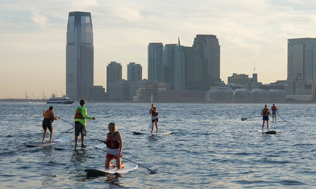 SUP with NYC in the background