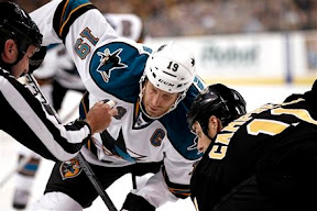 Joe Thornton sets to take a faceoff against Gregory Campbell
