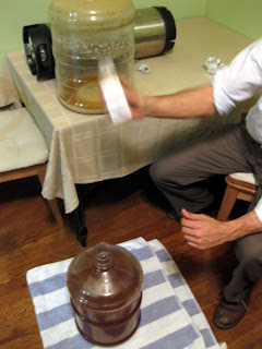 Nate giving the Brett Blend #1 a shake before pitching it into the wort.