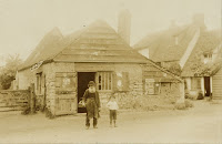"""""""Charles Elbourne died in 1908 but this photograph shows him walking down Church Street when he was 68 years of age accompanied by his little grandson Charlemagne, then 5 years and 8 months old; in 1914 he enlisted to fight the Germans."""" From A Record of Shelford Parva by Fanny Wale P37"""