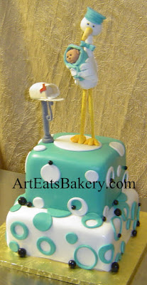 Two tier square teal, black and white polka dot cake with stork, baby and mailbox sugar figure topper