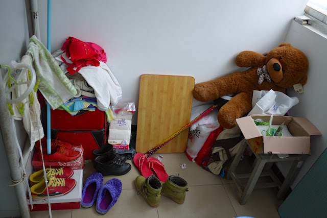 stuffed bearr, shoes, and other items inside a female dormitory room at Central South University of Forestry and Technology in Changsha, China.