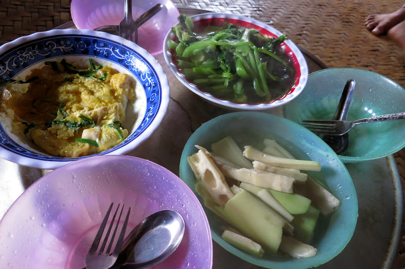 Breakfast of omelette, steamed bamboo shoots, boiled greens