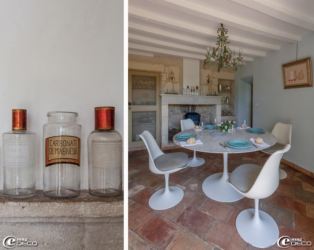 Pots à pharmacie chinés dans les brocantes, table et chaises Tulipe dessinées par Eero Saarinen pour Knoll, lustre chiné chez Florence Bouvier aux Puces du Canal de Villeurbanne