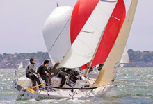 J/80 one-design sailboat- sailing upwind off Cowes, England
