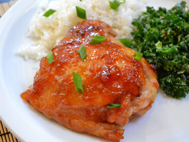 pineapple teriyaki chicken on plate with side dishes