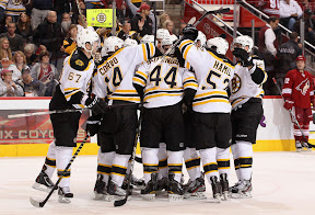 Bruins celebrate after scoring in overtime to win the game