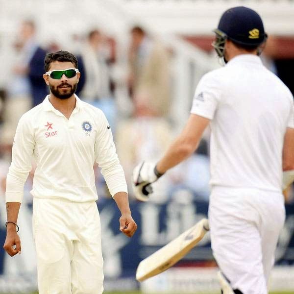 India's Ravindra Jadeja looks on after dismissing England's James Anderson (R) during the second cricket test match at Lord's cricket ground in London July 19, 2014.