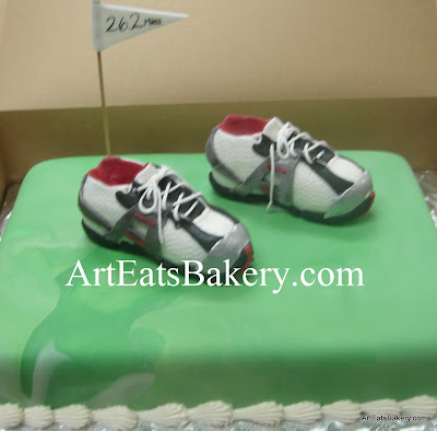 Pair of unique custom edible running shoes on green fondant groom's cake