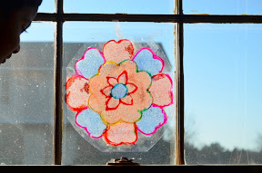 Upcycled plastic sheet sand art suncatcher