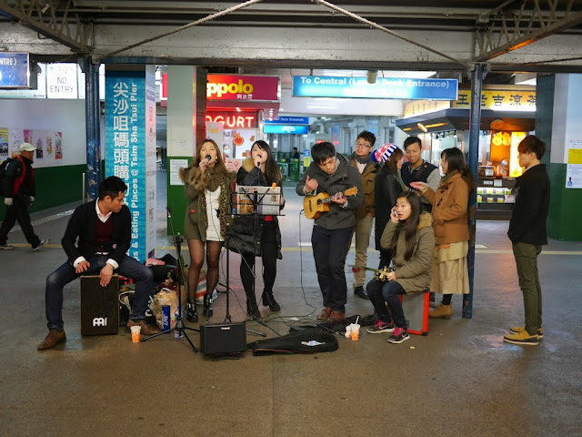 music group performing in front of the Star Ferry Pier