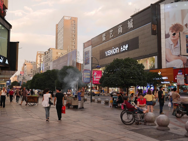 people walking on a pedestrian street in Changde