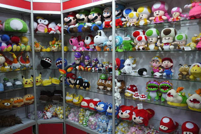 stuffed toys of Japanese cartoon characters in a wholesale store in Guangzhou, Guangdong