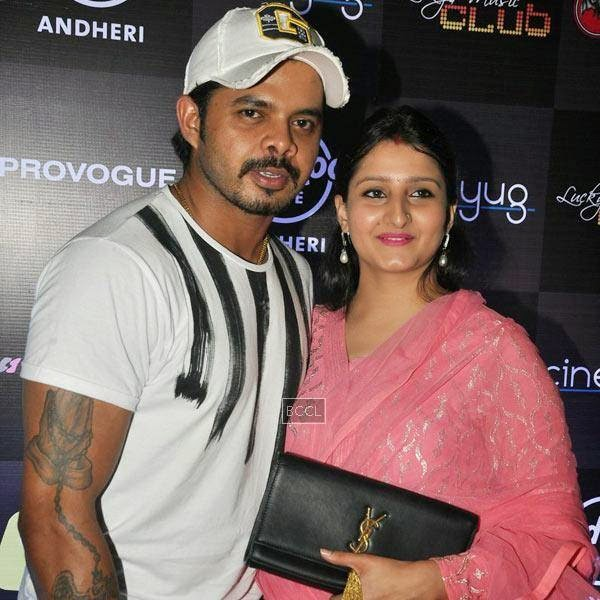 S Sreesanth arrives with his wife Bhuvneshwari Kumari for Ankit Tiwari's live concert, held at Hard Rock Cafe, on July 11, 2014.(Pic: Viral Bhayani)