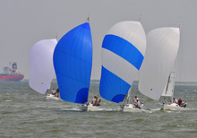 J/80 one-design sailboats- sailing downwind on Galveston Bay, Houston, TX