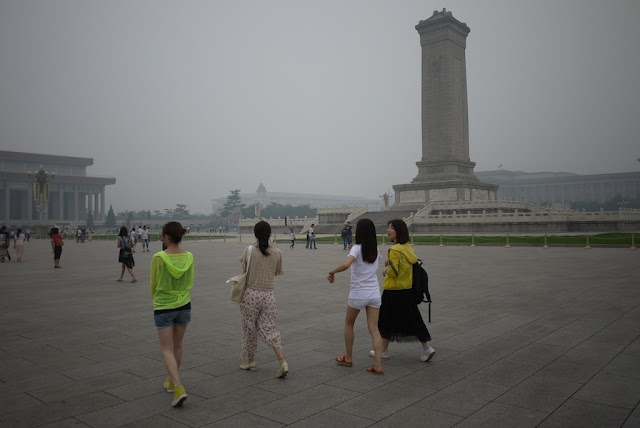young women walking at Tiananmen Square