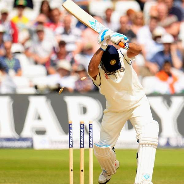 India's Mahendra Singh Dhoni is bowled by England's Liam Plunkett for 11 runs during the first cricket test match at Trent Bridge cricket ground in Nottingham, England July 13, 2014.