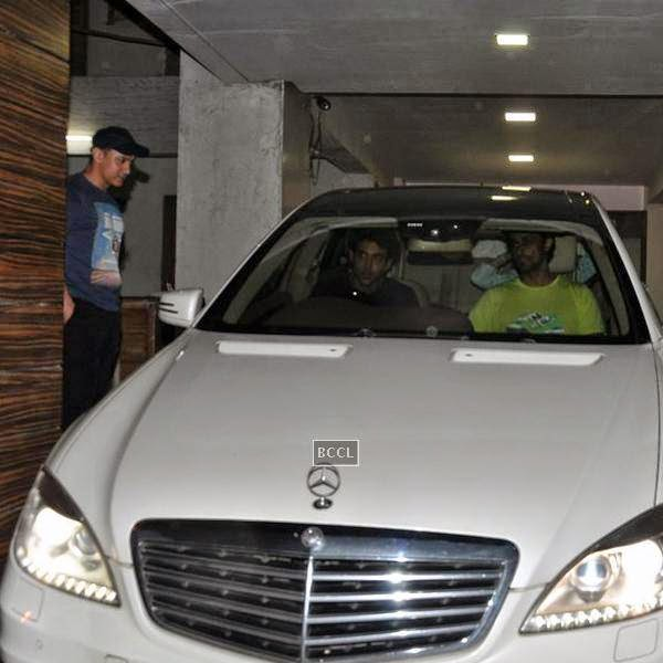 Hrithik Roshan and Kunal Kapoor leave after dining with Aamir Khan at his residence in Mumbai, on July 20, 2014.(Pic: Viral Bhayani)