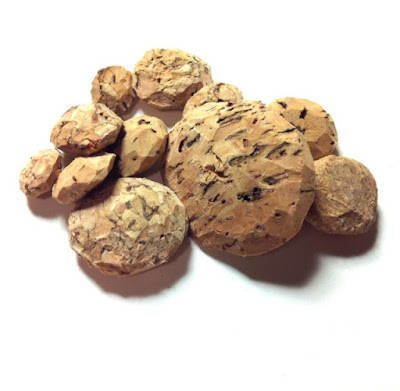 Cork carved intoa cluster of flat spherical shapes.