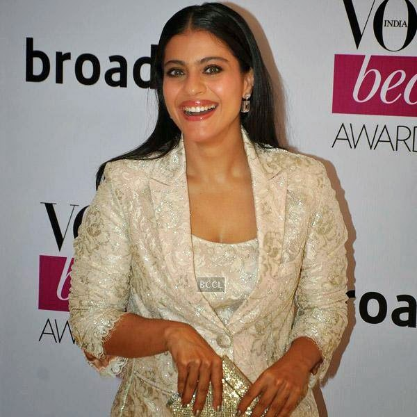 Actress Kajol is all smiles as she walks the red carpet for Vogue Beauty Awards 2014, held at Hotel Taj Lands End in Mumbai, on July 22, 2014.(Pic: Viral Bhayani)