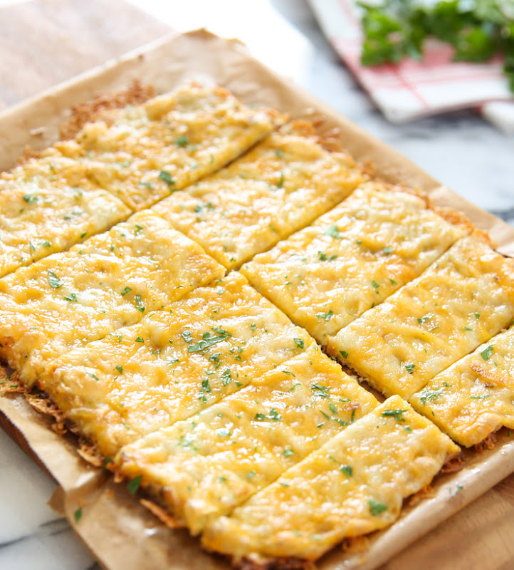 sliced cauliflower breadsticks on parchment paper