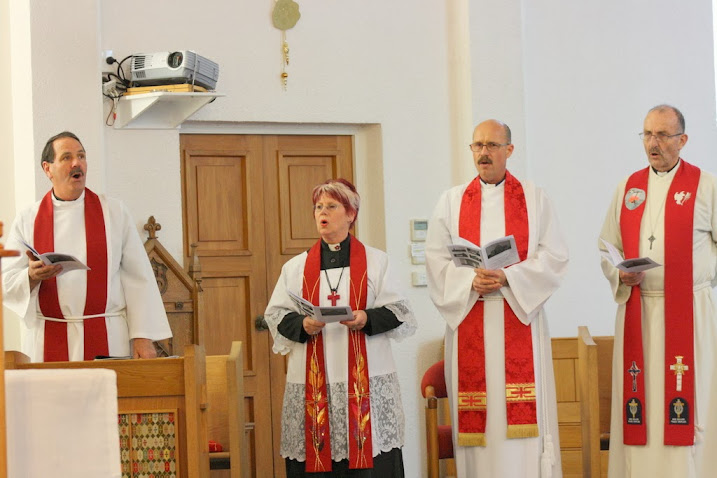 Clergy sing a hymn