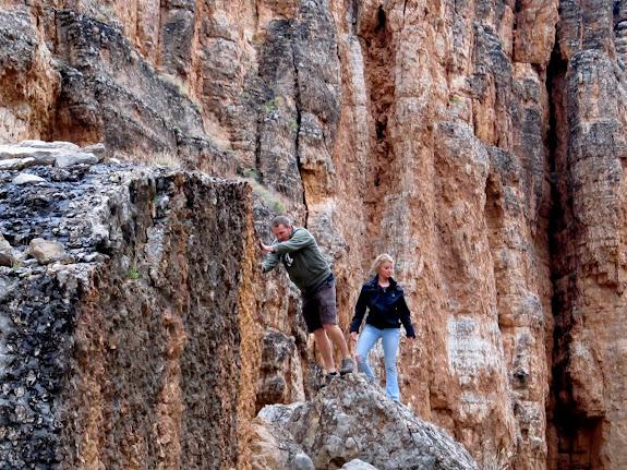 Chris and Karin scrambling on boulders
