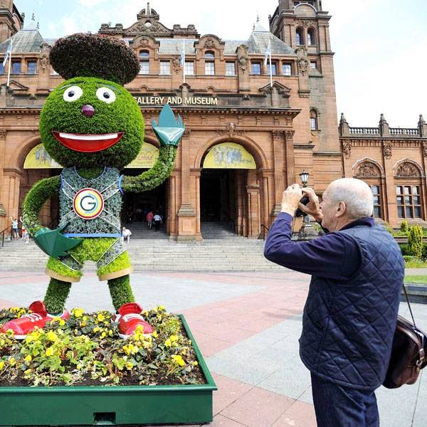 A topiary rendering of the 2014 Commonwealth games mascot Clyde Thistle is displayed outside Kelvingrove Museum and Art Gallery next to the Lawn Bowls arena in Kelvingrove Park, Glasgow on July 22, 2014, ahead of the opening of the 2014 Commonwealth Games in the city of July 23, 2014.