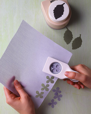 Using craft punches, punch out petals and leaves as close together on the fabric as possible.