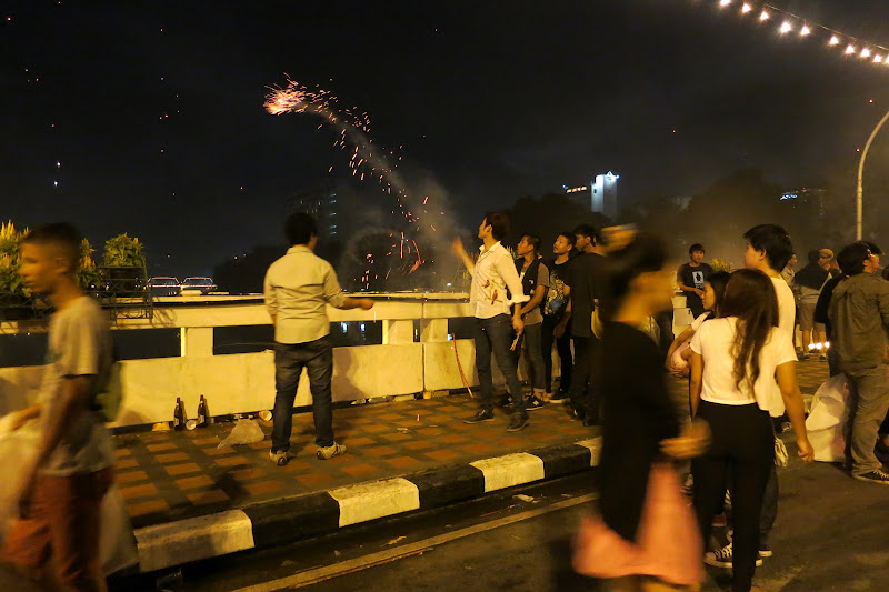 Throwing fireworks off the bridge