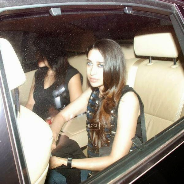 Karisma Kapoor leaves after attending Karan Johar's party, organised at his residence, on July 26, 2014.(Pic: Viral Bhayani)