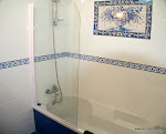 Bathroom detail with hand painted tile panel